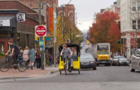 Downtown Asheville Street With Traffic and a Bike Taxi