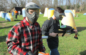 young men in recovery playing paintball