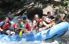 men white water rafting