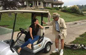 golfer chatting with woman