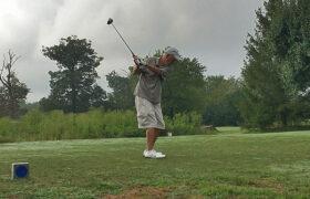 man golfing for benefit